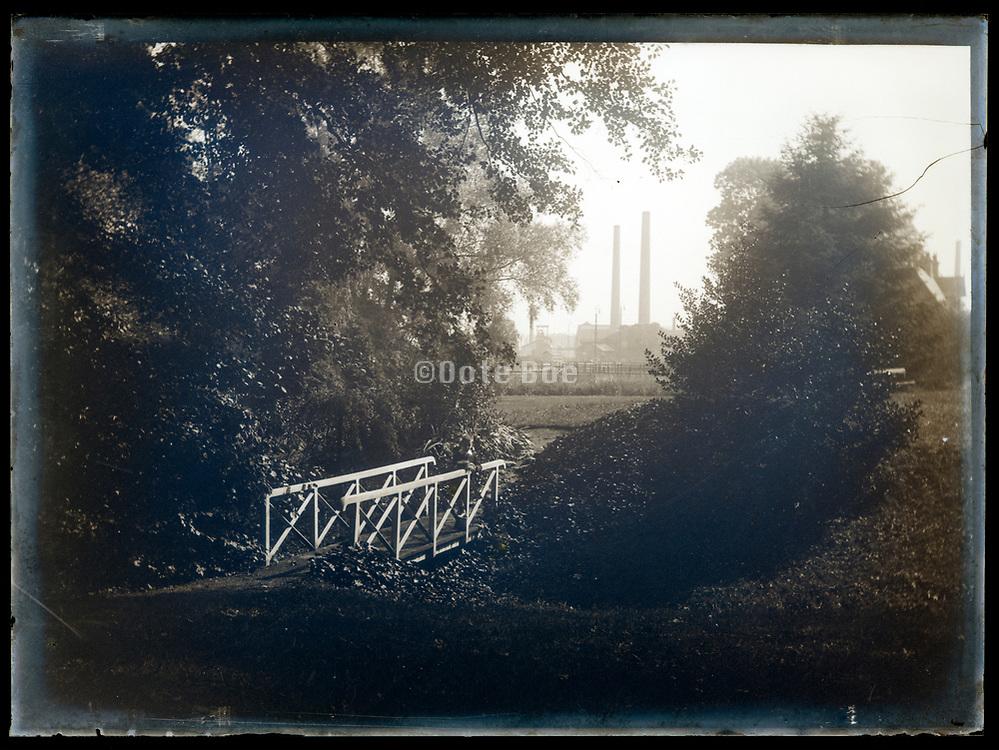 idyllic nature view towards factory chimneys France ca 1920s