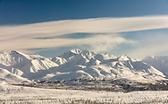 Late afternoon light on Chugach Mountains at Tahneta Pass in Southcentral Alaska. Winter.