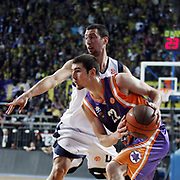Fenerbahce Ulker's Roko Leni UKIC (B) and Power Electronics Valencia's Nando De COLO (F) during their Euroleague Basketball Top 16 Game 2 match Fenerbahce Ulker between Power Electronics Valencia at Sinan Erdem Arena in Istanbul, Turkey, Thursday, January 27, 2011. Photo by TURKPIX