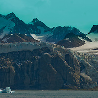 Hanging glaciers in the Salvesen Range pour into the South Atlantic Ocean near Gold Harbor, South Georgia, Antarctica.