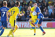 Oxford United attacker Jamie Mackie (19) and AFC Wimbledon defender Ben Purrington (3) battles for possession during the EFL Sky Bet League 1 match between AFC Wimbledon and Oxford United at the Cherry Red Records Stadium, Kingston, England on 29 September 2018.