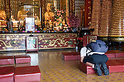 Asia, Southeast, People's Republic of China, Hong Kong, praying at the temple of 10,000 Buddhas