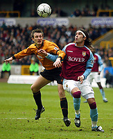Photo: Scott Heavey.<br /> Wolverhampton Wanderers v Aston Villa. FA Barclaycard Premiership. 14/03/2004.<br /> Lee Naylor (L) is caught out by Villa's Juan Pablo Angel who goes on to score Villa's third