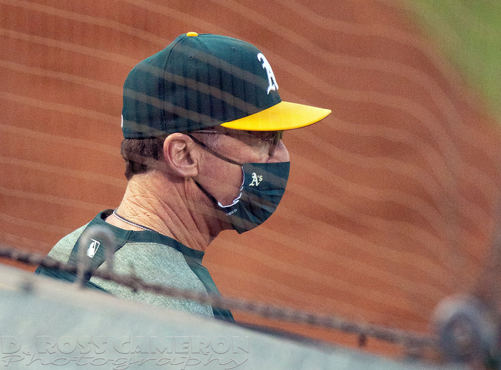 Sep 25, 2020; Oakland, California, USA; Oakland Athletics manager Bob Melvin (6) watches his team take on the Seattle Mariners during the first inning of a Major League Baseball game at Oakland Coliseum. Mandatory Credit: D. Ross Cameron-USA TODAY Sports
