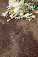 May 28, 2019, Kawasaki, Japan: View of the aftermath where two victims died with their bloodstains still visible in front of a makeshift memorial. These were victims of a man who went on a morning rampage attacking people with knives at a bus stop close to Noborito Station in a sleepy suburb outside Tokyo. Three died and sixteen were injured with three still in critical condition. Many of the victims were children waiting for their school bus to take them to Caritas Gakuen, a Catholic elementary school located about one kilometer from the scene. Caritas was founded by Soeurs de la Charite de Quebec, a Catholic nun organization from Quebec, Canada. Among the dead were 11 year old Hanako Kuribayashi, a female sixth grader from Tokyo, and 39 year old Satoshi Oyama from Tokyo, an employee of Japan's Foreign Ministry. Oyama is the father of a student at the school who was not injured in the attack. The third death was the attacker, a 51 year old resident of Kawasaki who died from a self inflicted neck wound. His motive for the attack which began shortly after 7:30 am is unknown. Japan is one of the safest nations in the world which tightly controls weapon ownership, both guns and swords. Even so, knife rampages continue with the last one occurring in 2016 when a man attacked a mental care facility in Tsukui City killing 19 patients. Photo by Torin Boyd.