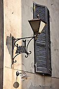 Lamp in Via Ricasoli in old hill town of Montalcino, Val D'Orcia,Tuscany, Italy