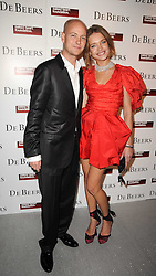 The HON.JUSTIN PORTMAN and NATALIA VODIANOVA at The Love Ball hosted by Natalia Vodianova and Lucy Yeomans to raise funds for The Naked Heart Foundation held at The Round House, Chalk Farm, London on 23rd February 2010.