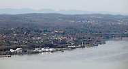Cornwall, New York - A view of the Hudson River and the Newburgh waterfront from Storm King Mountain State Park on March 27, 2010. The Newburgh Beacon Bridge is on the right. The Catskill Mountains are in the background.
