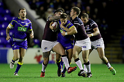 Warrington's Matty Russell gets tackled by leeds rhinos during the Betfred Super League match at the Halliwell Jones Stadium, Warrington.