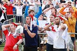 """© Licensed to London News Pictures . 03/07/2021. Manchester, UK. Crowd reacts to Declan Rice failed shot on goal. Football fans watch the European Cup tie between Ukraine and England , being played in Rome , via screens at a """"4TheFans Fan Park"""" at Event City in Trafford , North West England . Photo credit: Joel Goodman/LNP"""