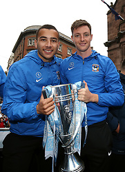 Coventry City's Rod McDonald (left) and Dominic Hyam hold the trophy during the Sky Bet League Two promotion parade in Coventry.