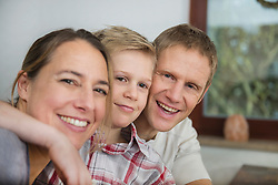 Parents and son together at home