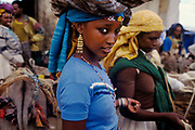 Girl at street market, Hara. Situated in Eastern Ethiopia it is considered to be the fourth  holiest city in Islam with 82 mosques. It is a major commercial centre linked by trade routes with the rest of Ethiopia and the entire Horn of Africa.  Ethiopia