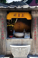Altars with offerings from worshippers at A-Ma Temple in Macau.