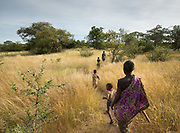 Women and Isaya going to dig for tubers. At the Hadza camp of Senkele.
