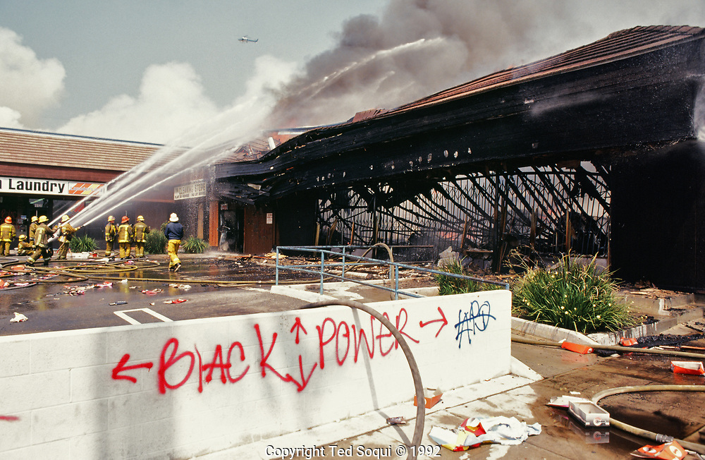 A mini-mall is looted and burned in South Central Los Angeles.