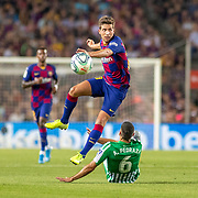 BARCELONA, SPAIN - August 25:  Sergi Roberto #20 of Barcelona avoids the challenge of Alfonso Pedraza #6 of Real Betis during the Barcelona V  Real Betis, La Liga regular season match at  Estadio Camp Nou on August 25th 2019 in Barcelona, Spain. (Photo by Tim Clayton/Corbis via Getty Images)