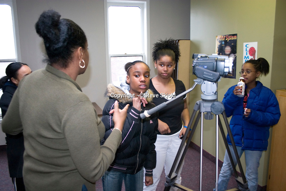 Girls recording videos of their stories. Youth Express Girls Self-Esteem Program St Paul Minnesota USA