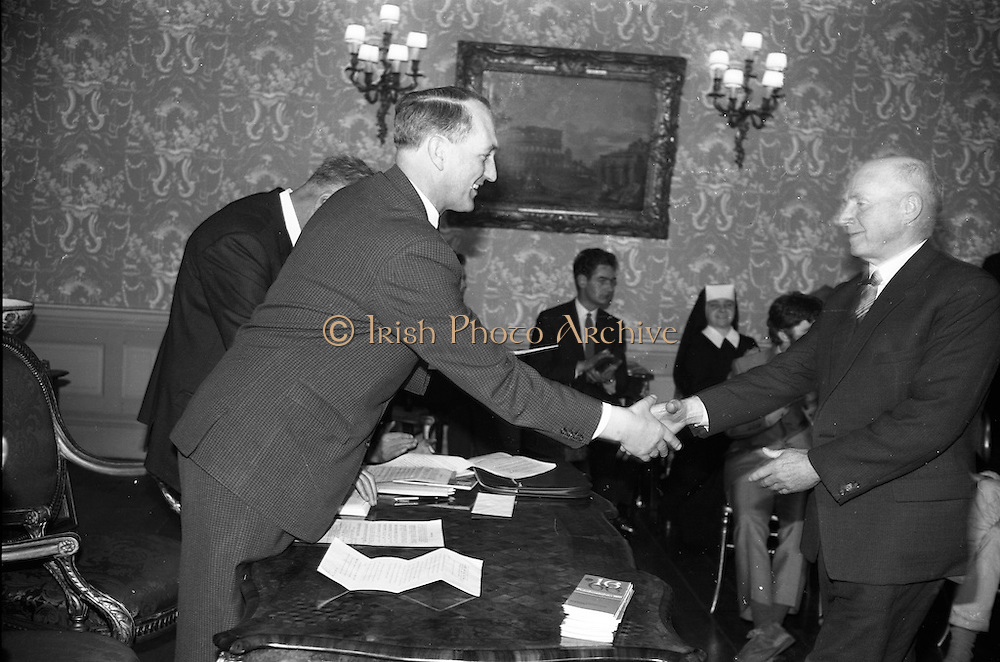 """23/05/1966<br /> 05/23/1966<br /> 23 May 1966<br /> 1916 Art prizes presented at Iveagh House. Prizes for literature, music and art offered by the 1916 Golden Jubilee Commemoration Committee were presented by the Minister for Education Mr. George Colley T.D. at a ceremony at Iveagh House, Dublin. Picture shows Mr. Florence O'Donoghue, Loughlene, Eglantine Park, Douglas Road, Cork (right) receiving his prize of £200 for his literary work """"The failure of the German Arms landing at Easter 1916 - a new interpretation""""."""