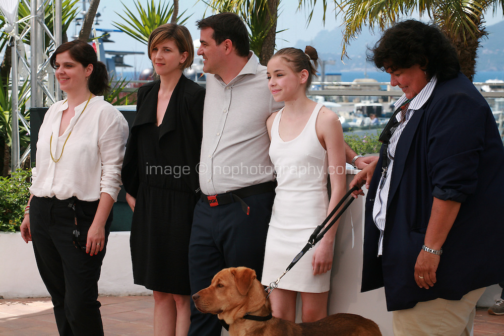 Producer Viktoria Petranyiata, writer Kata Weber, director Kornel Mundruczo, actress Zsofia Psotta, Hagen the Dog and animal trainer Teresa Ann Miller at the photo call for the film White God (Feher Isten) at the 67th Cannes Film Festival, Saturday 17th May 2014, Cannes, France.