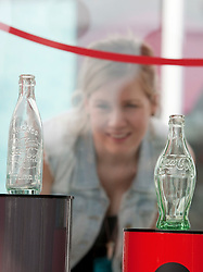 © Licensed to London News Pictures.  20/05/2011. London, UK. Melanie Jack, 25, from Hackney looking at classic coke bottle designs. Coca-Cola launches a free installation at the Design Museum Tank  showcasing a selection of the brand's memorable past designs, marking its 125th anniversary. See special instructions for rates. Photo credit should read Bettina Strenske/LNP