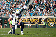 San Diego Chargers quarterback Philip Rivers (17) kneels on the field after a play during the first half of an NFL football game  against the Jacksonville Jaguars in Jacksonville, Fla., Sunday, Nov. 29, 2015. (AP Photo/Phelan M. Ebenhack)