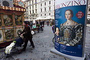 A modern Italian family and Agnolo de Cosimo Bronzino's painting of the Medici Eleanora of Toledo and son Giovanni C1545. The poster advertises the art exhibition by the celebrated painter Agnolo de Cosimo Bronzino. Agnolo de Cosimo Bronzino's painting of the Medici Eleanora of Toledo and son Giovanni C1545. Eleonora di Toledo (1522 – 1562), the daughter of Don Pedro Álvarez de Toledo, the Spanish viceroy of Naples. Eleonora was a patron of the new Jesuit order, and her private chapel in the Palazzo Vecchio  was decorated by Bronzino, who had originally arrived in Florence to provide festive decor for her wedding. She died, with her sons Giovanni and Garzia, in 1562, when she was only forty; all three of them were struck down by malaria while travelling to Pisa.