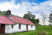 Quaint cottage dwelling with corrugated iron roof, Stoner's House, at Auchindrain highland farming township settlement and village folklore museum at Furnace near Inveraray in the Highlands of Scotland