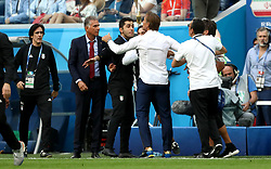 Tempers flare between Iran manager Carlos Queiroz (second left) and Morocco manager Herve Renard