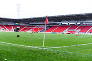 A general view of a corner flag at Keepmoat Stadium as two Doncaster players warm up before the The FA Cup fourth round match between Doncaster Rovers and Oldham Athletic at the Keepmoat Stadium, Doncaster, England on 26 January 2019.