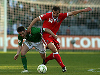 Photo: Paul Thomas.<br />Republic of Ireland v Wales. European Championships 2008 Qualifying. 24/03/2007.<br /><br />Robbie Keane (Green) of Ireland battles with Carl Flecther.