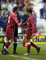Photo. Jed Wee<br />Middlesbrough v Bradford Reserves, The Riverside, Middlesbrough. 25/02/2003.<br />Middlesbrough's Juninho (R) is replaced by Gary Smith after a hugely successful return from an injury layoff.