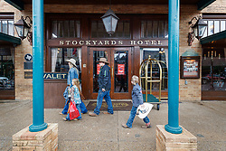 People walking in front of Stockyards Hotel, Fort Worth Stockyards National Historic District, Fort Worth, Texas, USA.