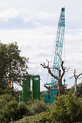 Drilling equipment for works connected to the HS2 high-speed rail link is prepared close to Harvil Road on 13th July 2020 in Harefield, United Kingdom. The rig is expected to be used imminently to drill into the chalk aquifer and environmental campaigners contend that such drilling risks contamination of the aquifer which supplies around 22% of London's drinking water.