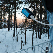 A remote terminator hangs at the end of a near-frozen cable as  Richard Lajeunesse prepares to install an additional transmitter on a tower providing Internet connectivity to the Ochiichagwe'Babigo'Ining Ojibway Nation reserve (also known as the Dalles First Nation) in Northern Ontario, Canada on 18 December 2016. Part of a project initiated by Chad Henry, then president of the band's youth council, the tower was established in 2013. According to residents it worked well initially, but service has been problematic since for a number of reasons, including heavy demand and storm damage. Lajeunesse is now working with the community's water treatment plant to provide them with a dedicated Internet link via the tower so that the plant can participate in a pilot program that will allow water quality to be monitored in real time from a central Water Hub being established at the Bimose Tribal Council in Kenora.