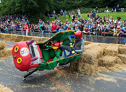 © London News Pictures. 12/07/2015. London, UK. A team competes in the 2015 Red Bull Soapbox race at Alexandra Palace in London on July 12, 2015. The  annual event sees amateur drivers race homemade soapbox vehicles down a 420m hill through obstacles, relying completely upon gravity to move. Photo credit: Ben Cawthra/LNP