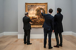 """© Licensed to London News Pictures. 04/12/2015. London, UK. Potential buyers view """"The Lock"""" by John Constable (est. £8-12 million), ahead of Sotheby's London evening sale of Old Master and British paintings on 9th December 2015. This is the first time that this painting has been on the market for 160 years.  Photo credit : Stephen Chung/LNP"""