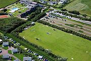 Nederland, Zeeland, Walcheren, 12-06-2009; Helikopters zijn geland op voetbalveld om gasten van bruiloft of partij te brengen naar recreatiecentrum.Swart collectie, luchtfoto (25 procent toeslag); Swart Collection, aerial photo (additional fee required); .foto Siebe Swart / photo Siebe Swart