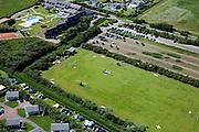Nederland, Zeeland, Walcheren, 12-06-2009; Helikopters zijn geland op voetbalveld om gasten van bruiloft of partij te brengen naar recreatiecentrum.Swart collectie, luchtfoto (25 procent toeslag); Swart Collection, aerial photo (additional fee required); .foto Siebe Swart / photo Siebe Swart