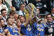 Sean Rigg lifting the trophy following the Sky Bet League 2 play off final match between AFC Wimbledon and Plymouth Argyle at Wembley Stadium, London, England on 30 May 2016.