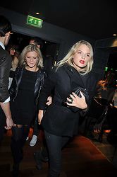 Left to right, OLIVIA PERRY and GABRIELLA ANSTRUTHER-GOUGH-CALTHORPE at the launch of the new Chinawhite at 4 Winsley Street, London on 21st October 2009.