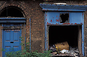 The rotting blue door of a Victorian terraced house now dilapidated and abandoned on the streets of Toxteth, on 14th June 1991, in Liverpool, England. Toxteth is an inner-city area of Liverpool, Merseyside, located to the south of the city and, in the 1990s, was synonymous with social issues, degradation and poverty with some of the most underprivileged families in the UK. Recently many streets in the worst areas have been demolished including Beatle Ringo Starr's childhood home.