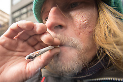 Smoking a joint using tobacco and Happy Joker, a legal high that has a similar effect to cannabis