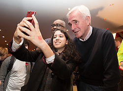 © Licensed to London News Pictures. 24/10/2015. London, UK. Shadow Chancellor,  John McDonnell poses for a selfie with a fan at the Labour Party Momentum event held at the Waterlilly in Whitechapel, east London. Momentum is a new successor entity to the Jeremy Corbyn for Labour Leader campaign which works with people who supports Corbyn's aim of creating a more fair, equal and democratic society. Photo credit : Vickie Flores/LNP