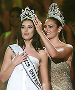 Miss Russia, Oxana Fedorova (L) reacts as she is crowned Miss Universe 2002  by Miss Universe 2001 Denise Quinones in San Juan, Puerto Rico May 29, 2002. The 24-year-old, from Pskov, Russia, is the first from her country to be crowned. REUTERS/Colin Braley