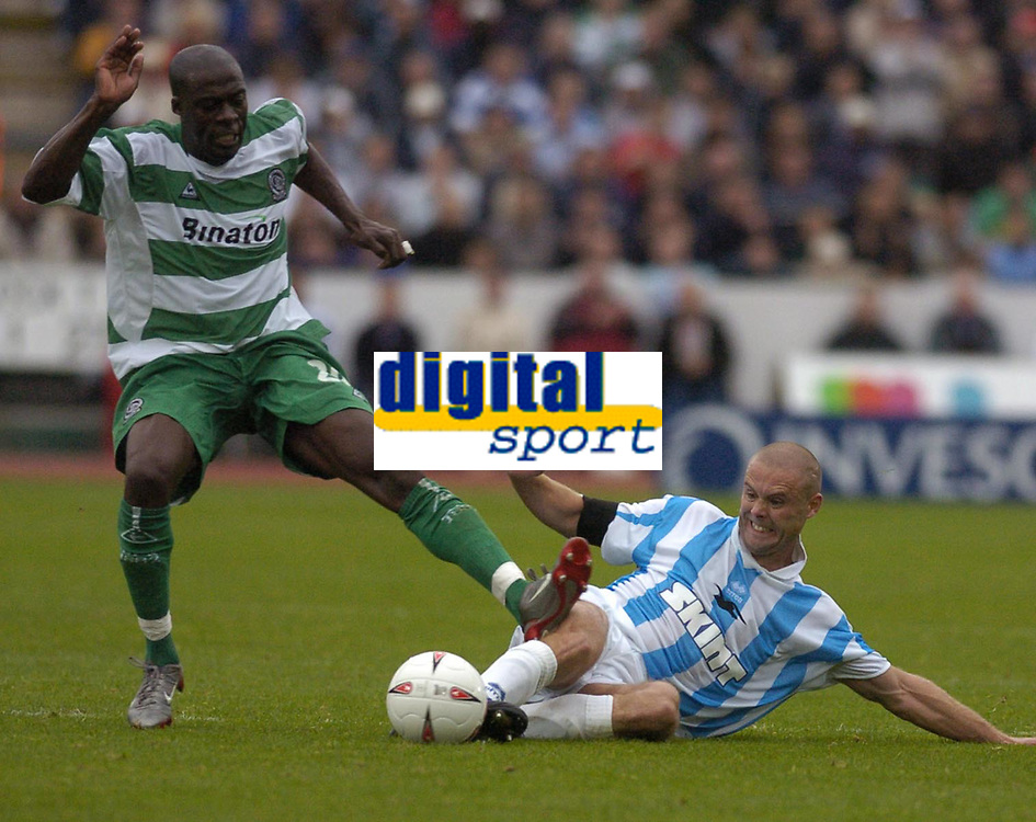 Photo: Alan Crowhurst. Brighton v Qpr, 18/09/2004, Coca-Cola Championship. Danny Cullip goes in hard with Paul Furlong L