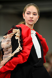© Licensed to London News Pictures. 02/06/2019. LONDON, UK.  A model presents a look by Eve Goulay from Glasgow School of Art in the GFW Collective show on day one of Graduate Fashion Week taking place at the Old Truman Brewery in East London.  The event presents the graduation show of up and coming fashion designers from UK and international universities.  Photo credit: Stephen Chung/LNP