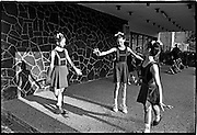 Young girls practice their ballet skills in front of their school.  Cuba is known for its excellent ballet academy.