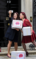 © Licensed to London News Pictures. 08/10/2018. Labour MP LUCIANA BERGER is joined by campaigner NATASHA DEVON as they hand the Mental Health First Aid England  petition titled 'Where's Your Head At?', at the front door of 10 Downing Street, calling for a law change. Photo credit: Ben Cawthra/LNP