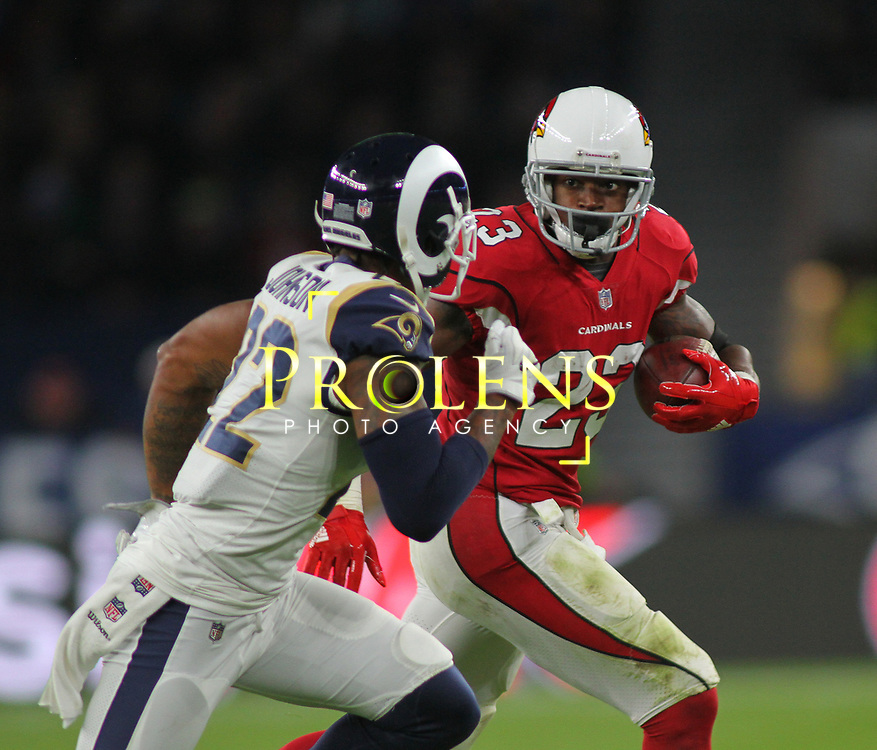 LONDON, ENGLAND - OCTOBER 22: Arizona Cardinals running back Adrian Peterson (23) runs with the ball during the NFL match between the Arizona Cardinals and the Los Angeles Rams at Twickenham Stadium on October 22, 2017 in London, United Kingdom. (Photo by Mitchell Gunn/ESPA-Images)
